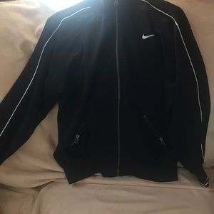 Woman's VINTAGE NIKE  TRACK JACKET size medium